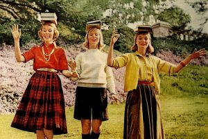Girls learning poise with books on their heads in the late 50s