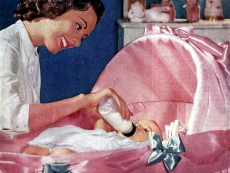 Giving baby a bottle - 1956