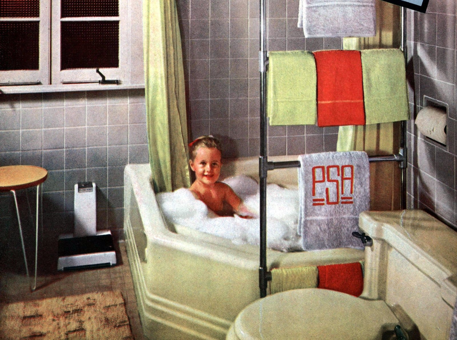 Gray wall tile with pale green bathroom fixtures from the 1950s