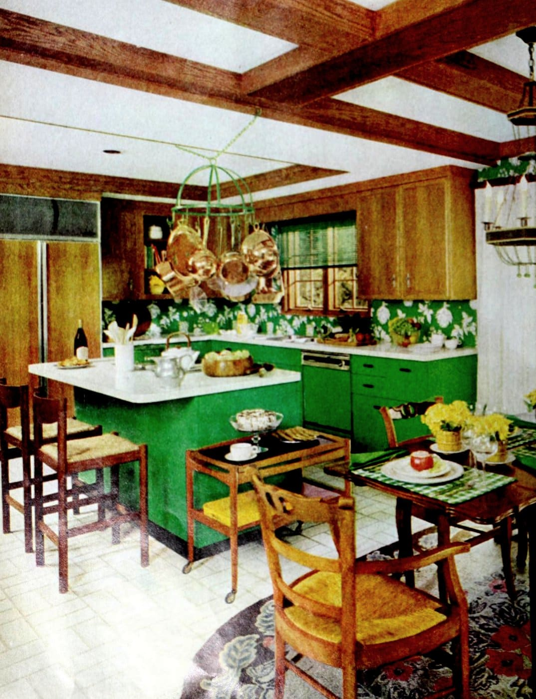 Green painted and stained wood cabinetry in vintage kitchen with an island (1977)
