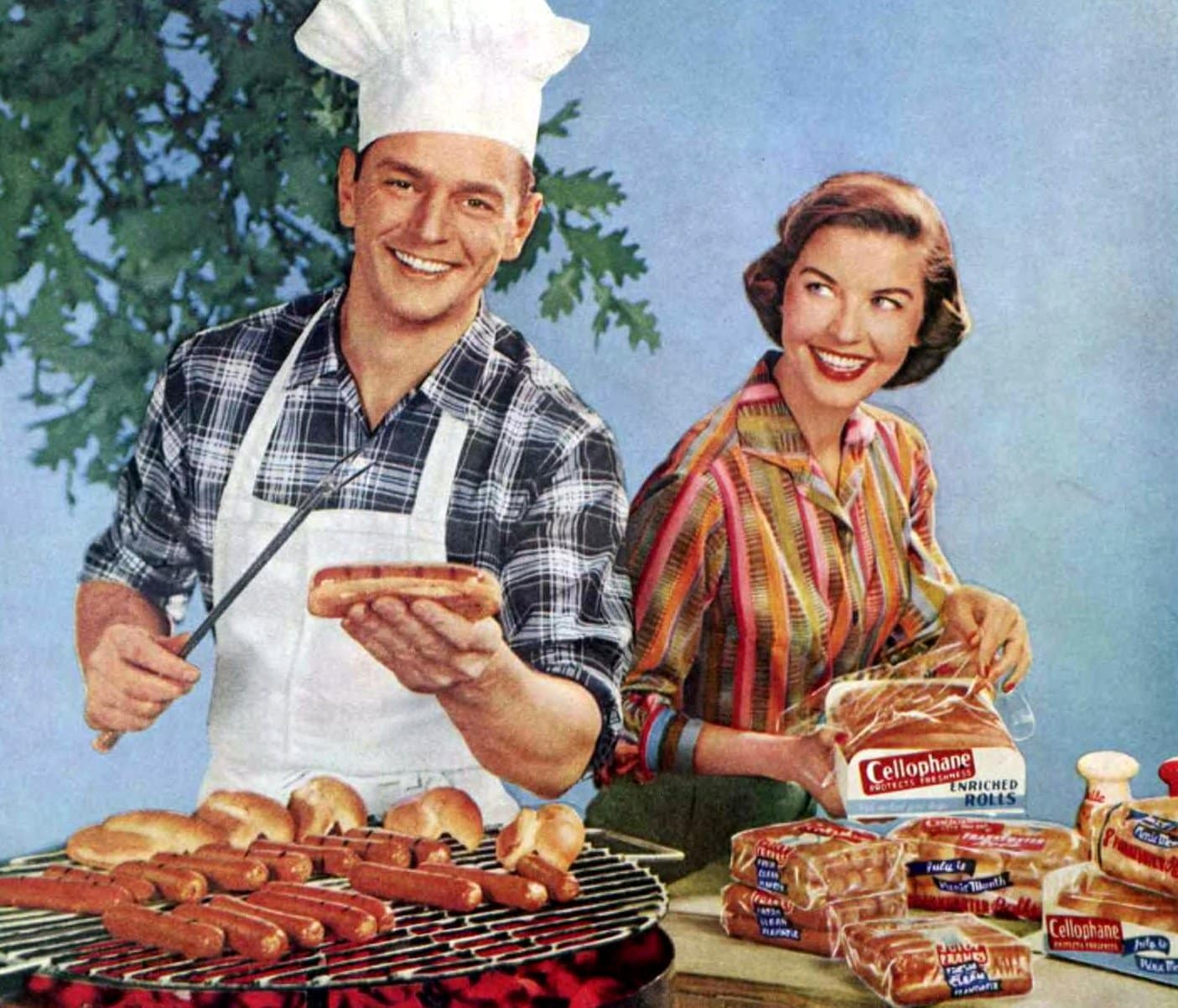 Happy couple grilling hot dogs on the BBQ (1956)