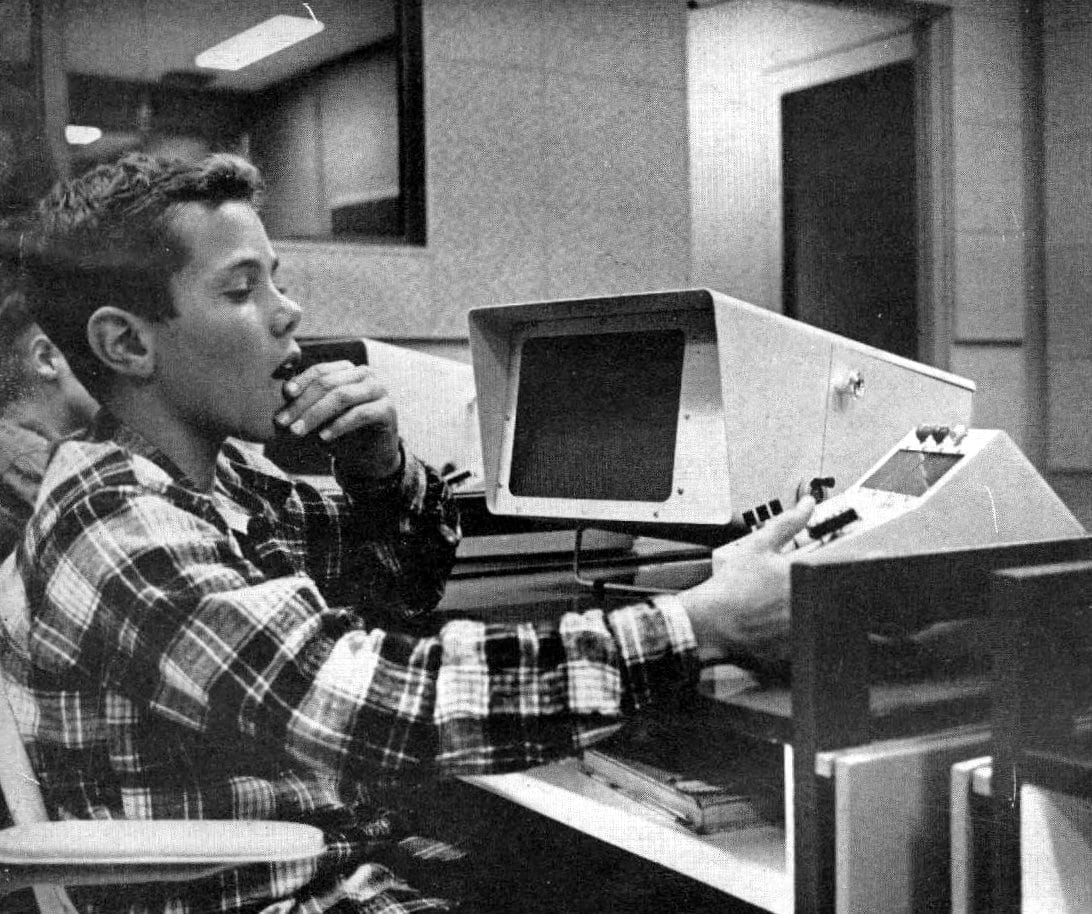 High school boy learning how to use a computer (1962)