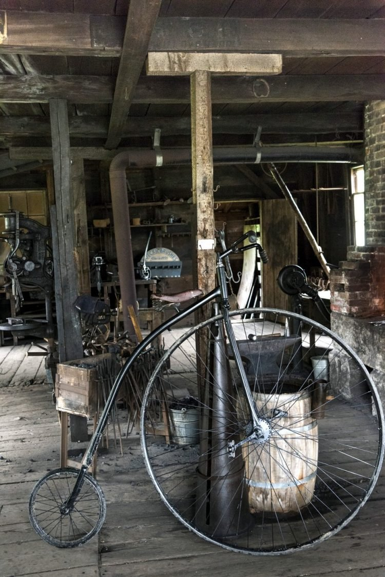 Penny farthing bicycle in workshop, Sherbrooke, Nova Scotia, Canada