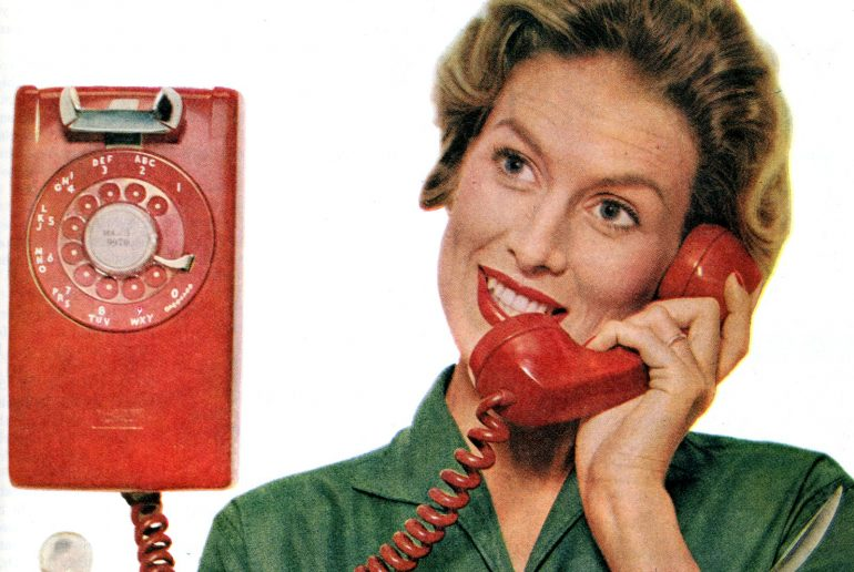 How do you use a rotary-dial phone