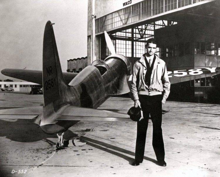 Howard Hughes with a plane