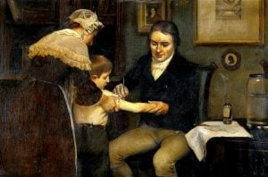 Dr Jenner performing his first vaccination, on James Phipps, a boy of 8. May 14, 1796