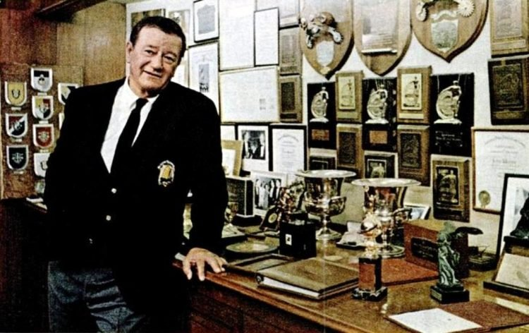 John Wayne in 1969 with his awards