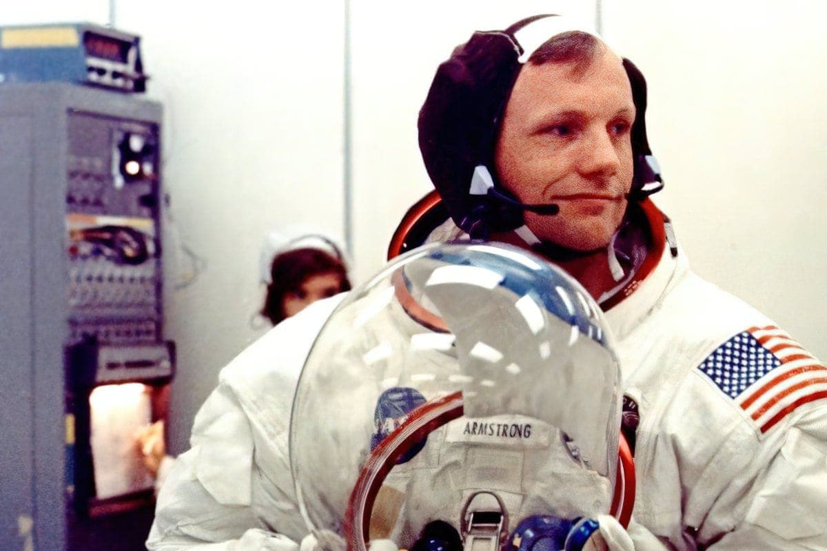 July 16, 1969, Apollo 11 commander Neil Armstrong prepares to don his helmet NASA