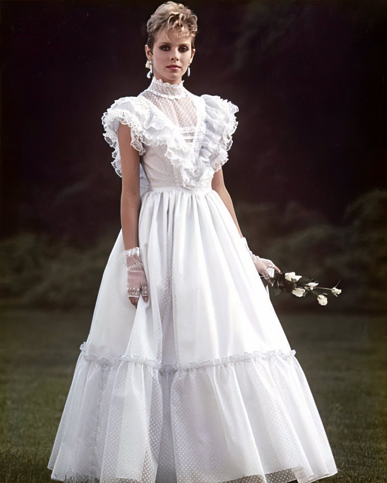 Lacy white mid-80s prom dress style