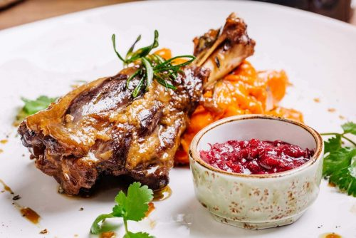 Braised lamb shank with roasted vegetables puree