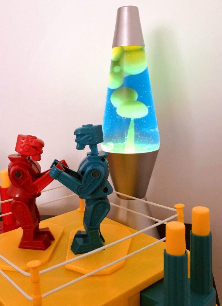 Lava lamp with vintage Rock 'Em Sock 'Em Robots toys