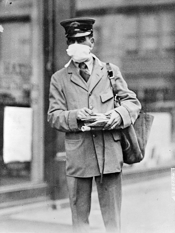 Letter carrier in New York wearing mask for protection against influenza. New York City 1918