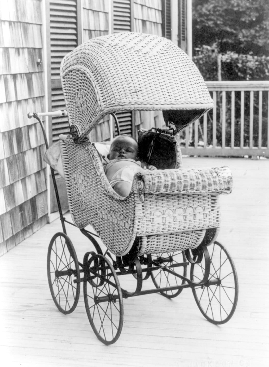 Little baby in a carriage napping outside (c1912)