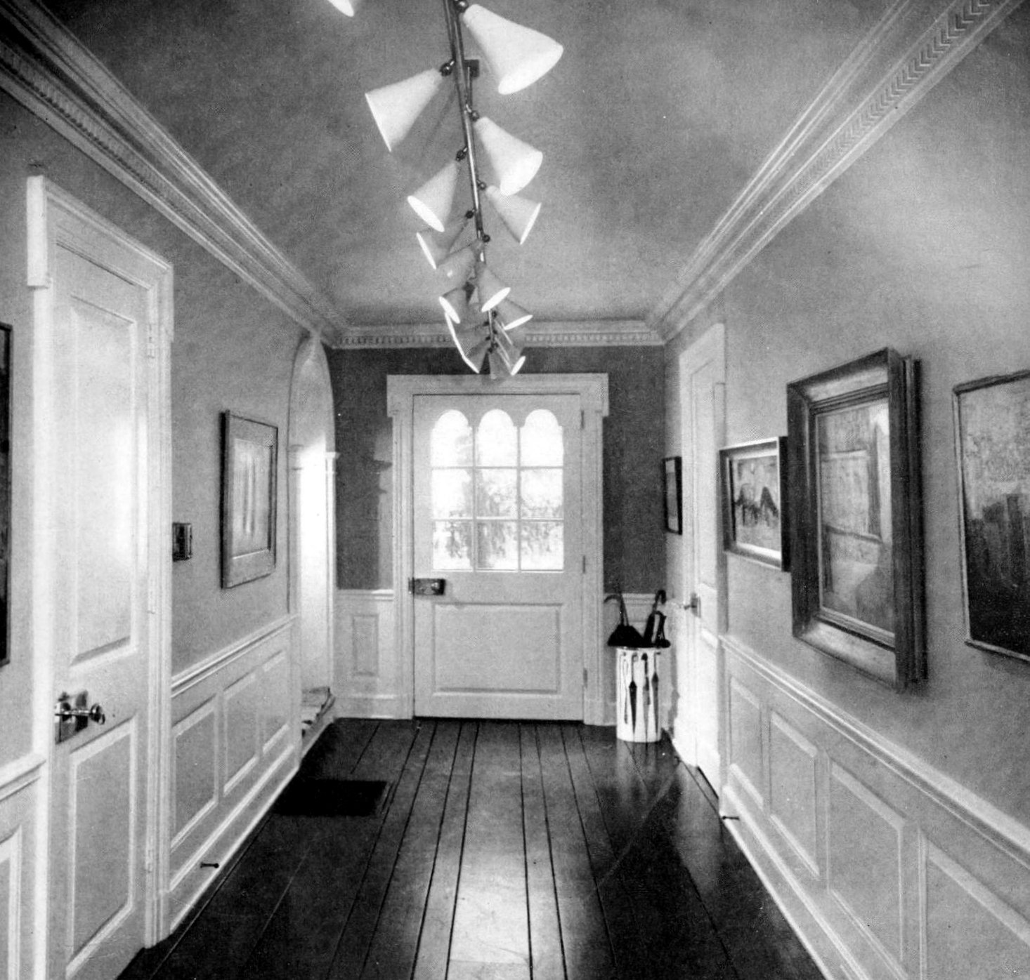 Long formal entry hall with hardwood flooring from 1959