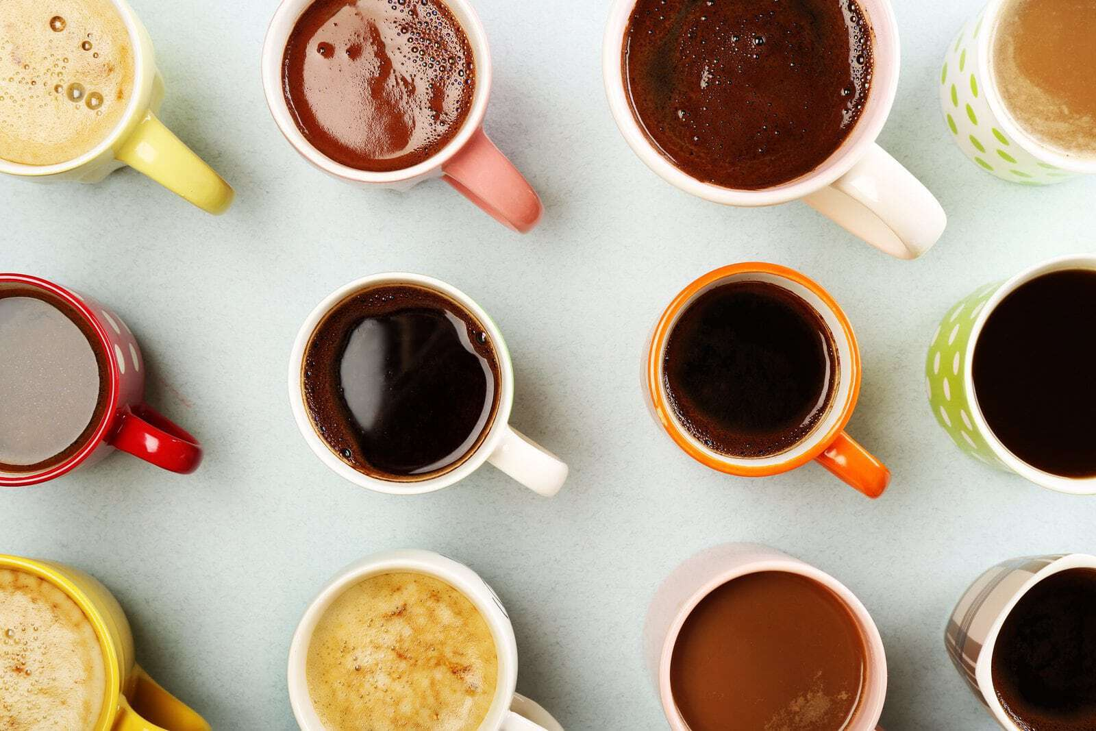 Many cups of coffee on table, top view