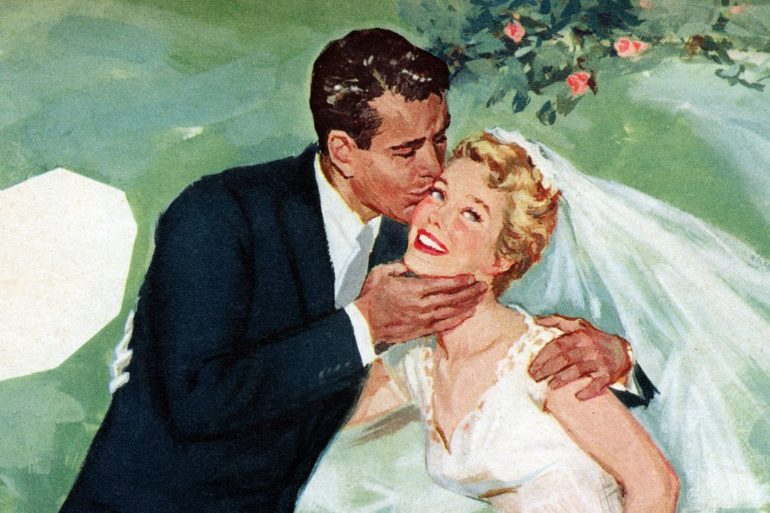 Man and woman from the fifties at their wedding - Groom kisses the bride