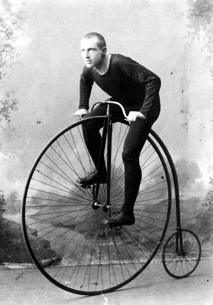 Man on a huge high wheel bikes