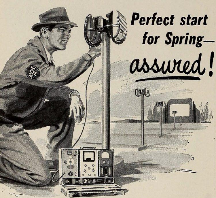 Man putting in vintage drive-in movie speakers - 1950