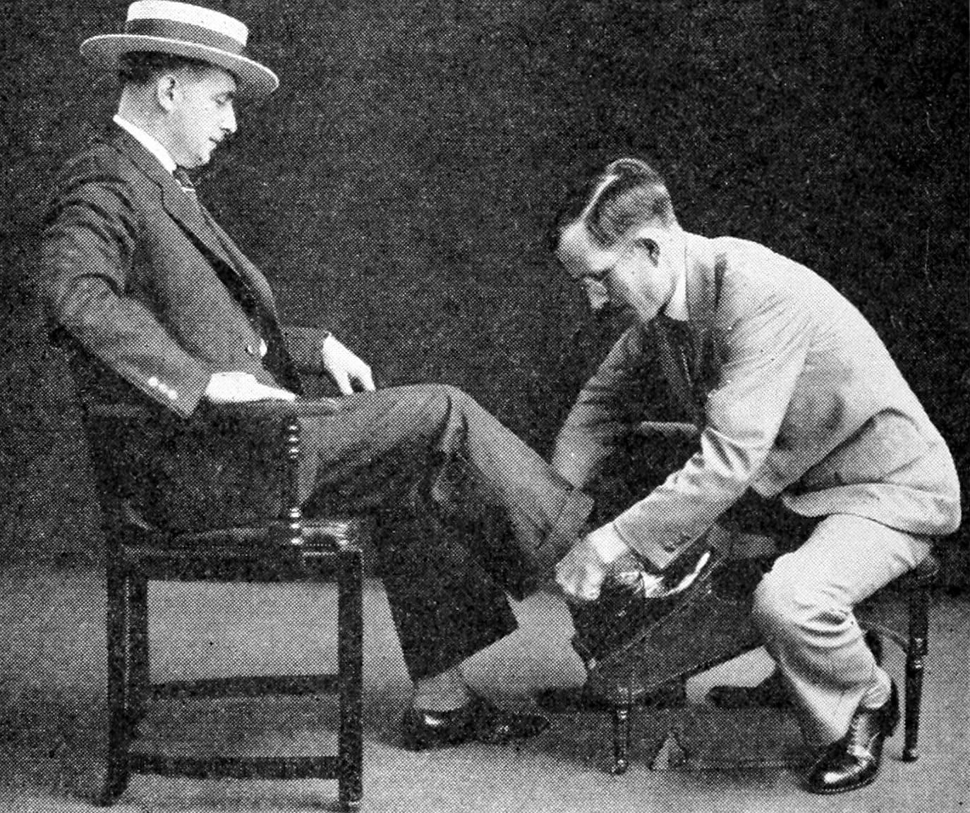 Man trying on shoes in the 1920s