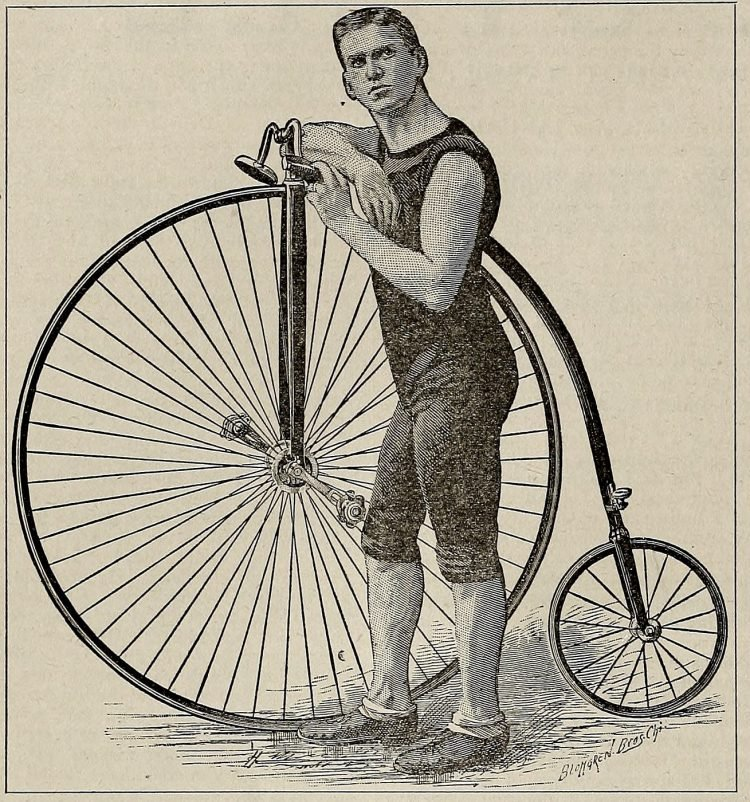 Man with a high wheel bicycles penny-farthing from the 1890s
