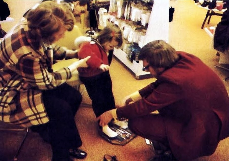 Measuring a child's feet at a shoe store (1973)