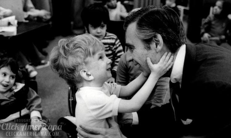 Mister Rogers - Fred Rogers - meets a happy child