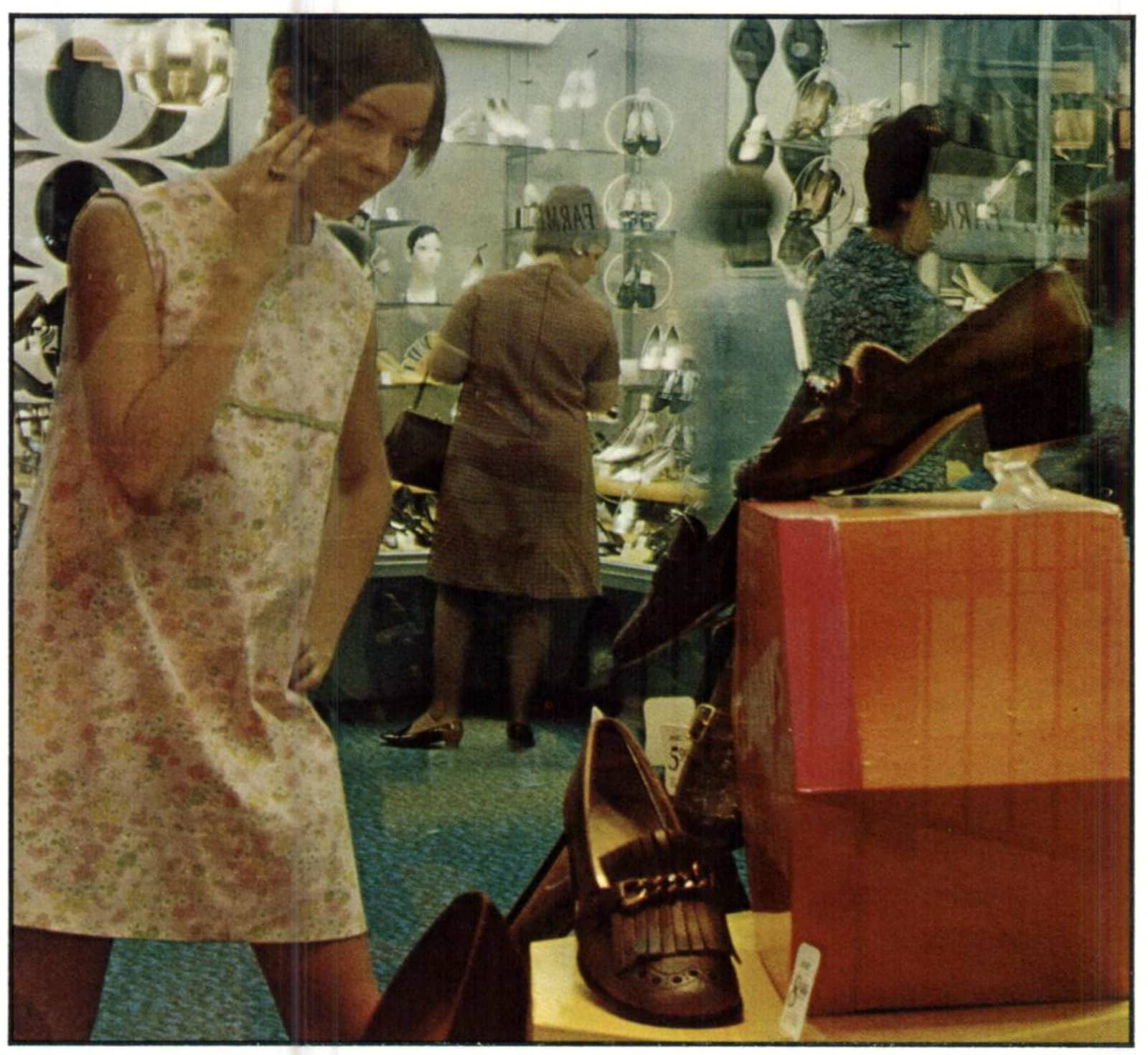 Mod sixties woman looking at a shoe store display in 1968