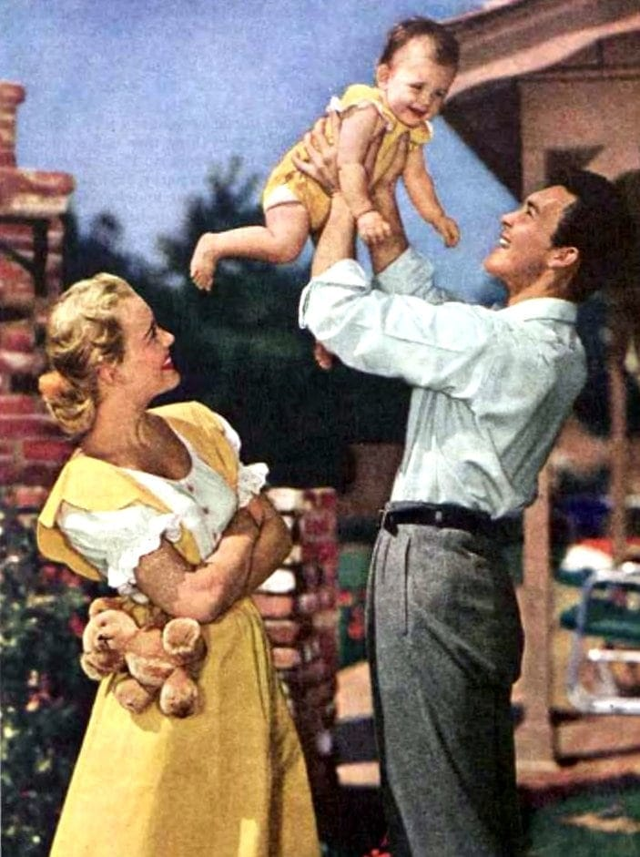Mom and dad with baby in 1952