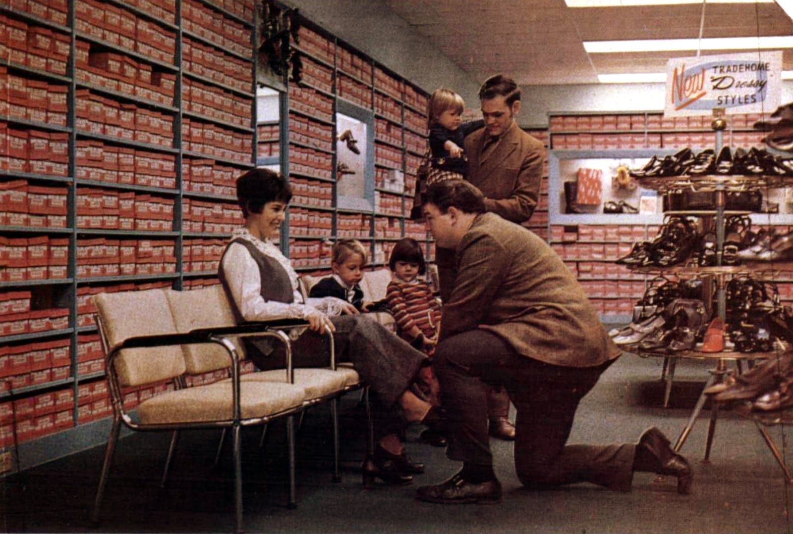 Mom with family trying on shoes (1969)