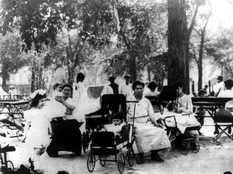 Mothers and children in a city park on a hot day, New York City