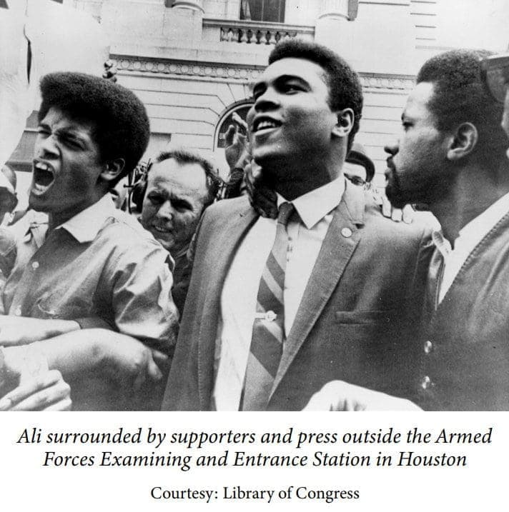 Muhammad Ali surrounded by supporters and press in Houston protesting military and Vietnam War