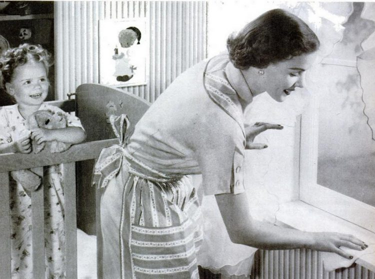 Oct 12, 1953 Housewife cleaning home