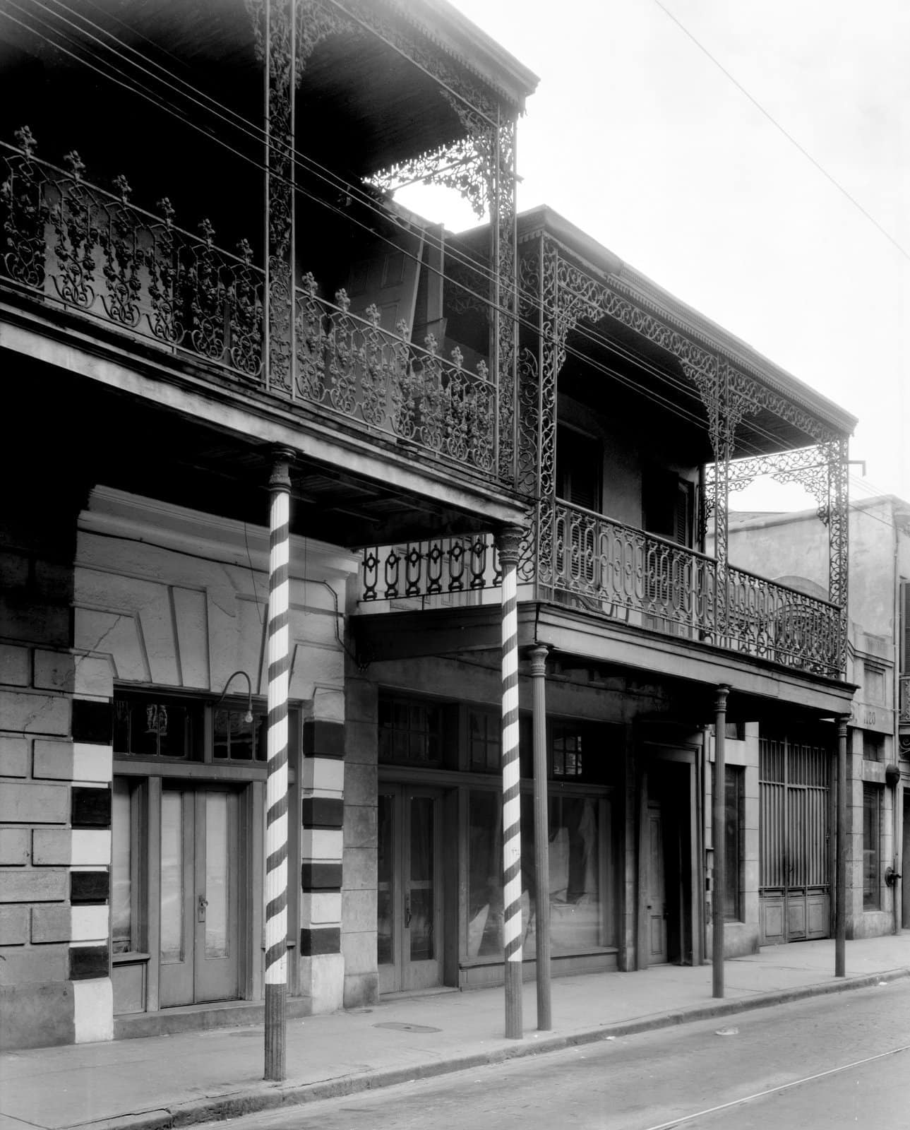 Old Southern wrought-iron balcony at Gallier House, 1132-1134 Royal St., New Orleans, Louisiana (1930)