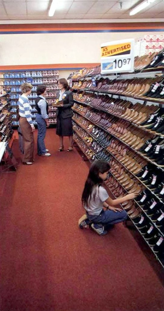 Old Walmart shoe aisles with sales associate (1982)