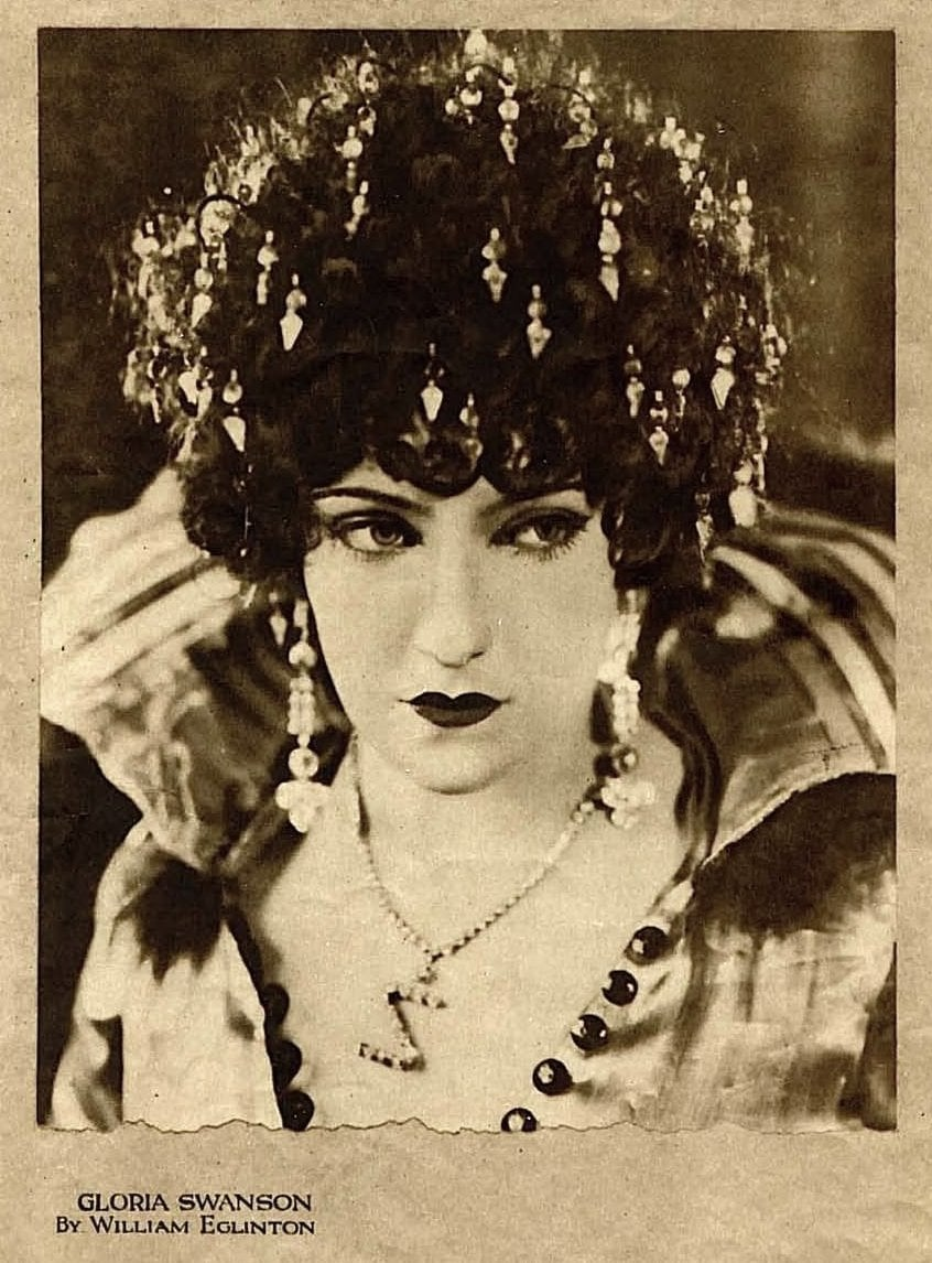 Old-fashioned 1920s womens hairstyles - actress Gloria Swanson with beaded hair