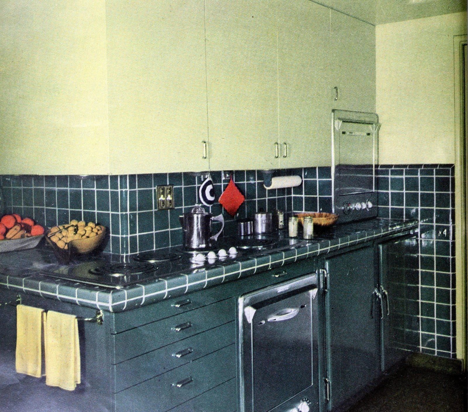 Old-fashioned blue tile kitchen with stainless steel appliances