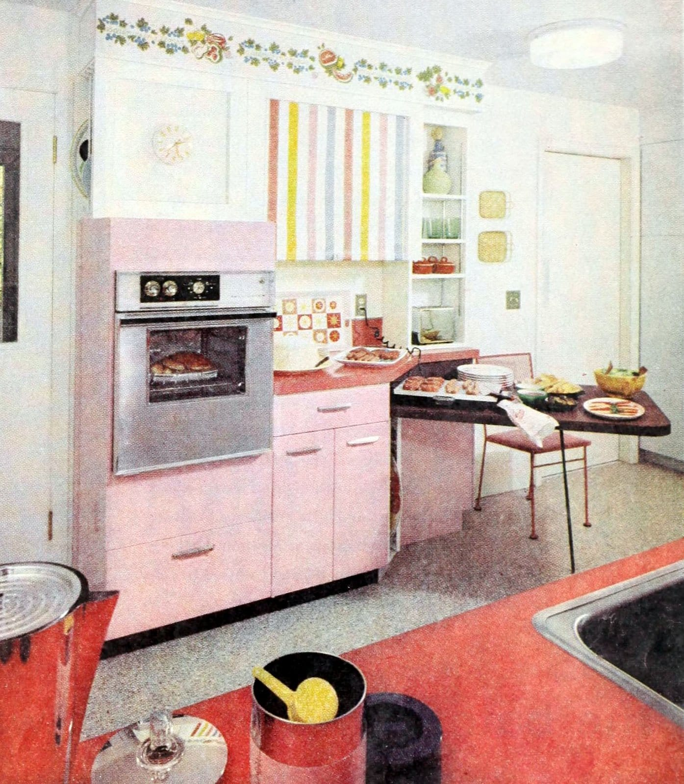 Old-fashioned fifties kitchen with pink and pastel decor plus red