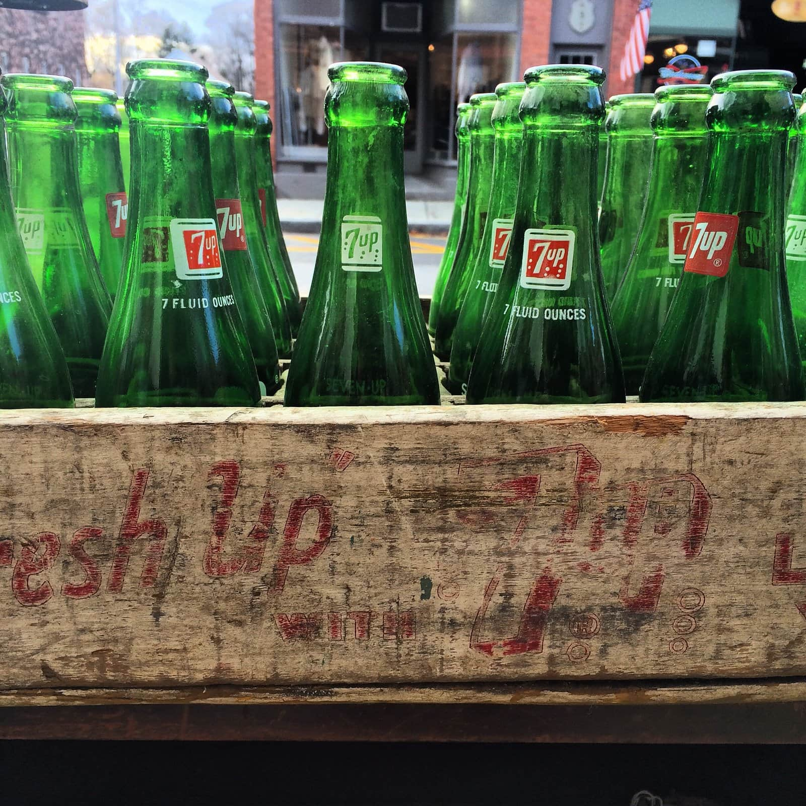 Old-fashioned green 7-UP soda bottles