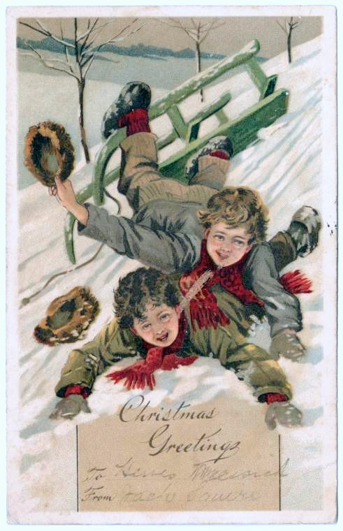 Old postcard with two boys on a sled in the snow from 1906 - Christmas greetings
