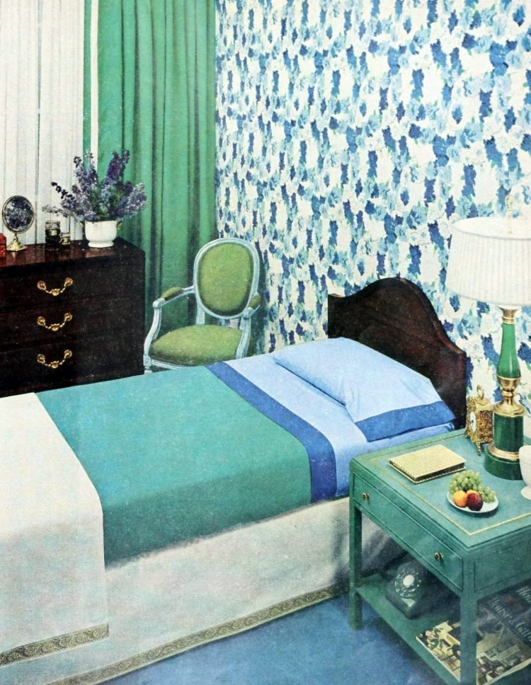 One of two single twin beds in blue and green vintage master bedroom from the 1950s