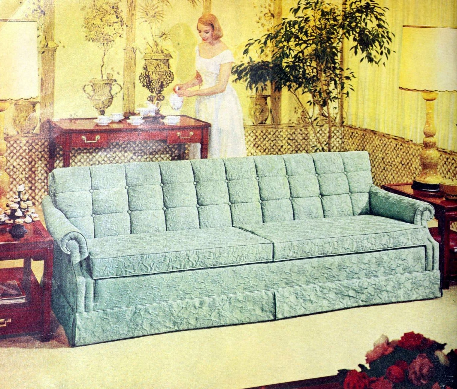 Pale blue-green sofa in the middle of a yellow sixties living room