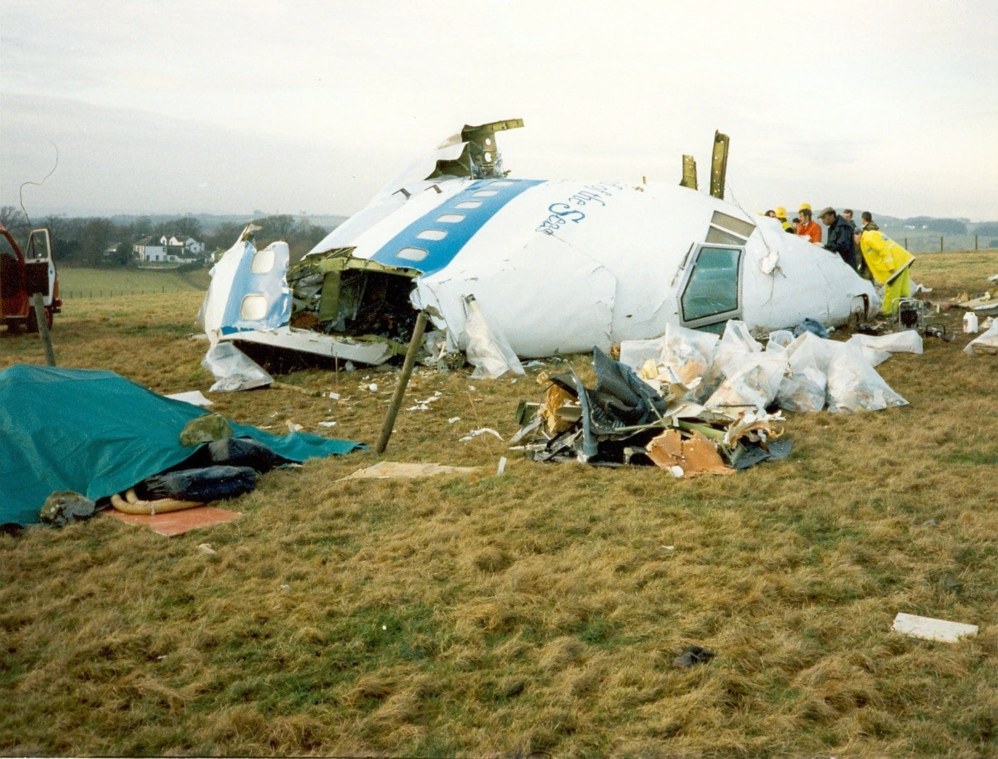 Pan Am Flight 103 nose in a field after bombing and crash (1988) - FBI photo