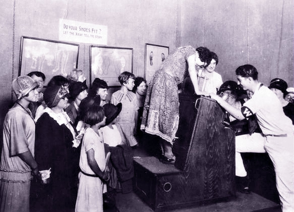 People lining up to use the X-ray shoe fitting machine (1920s)