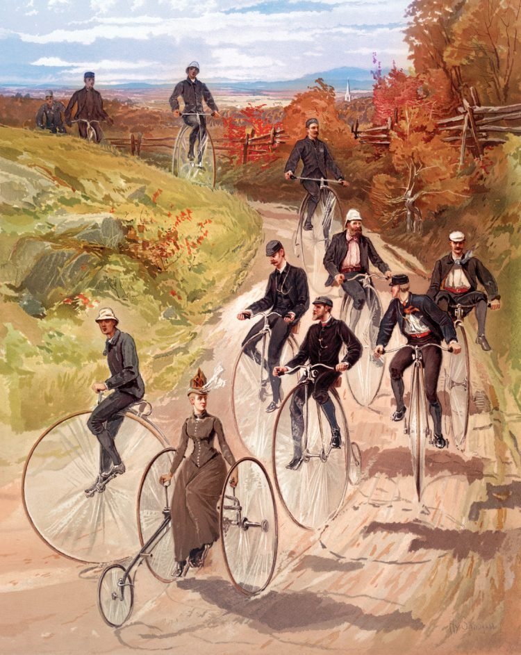 People riding old-fashioned high-wheel penny-farthing bicycles