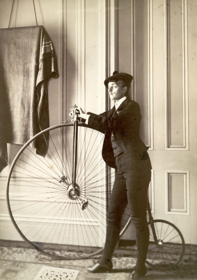 Person with a Victorian bicycle from the 1890s
