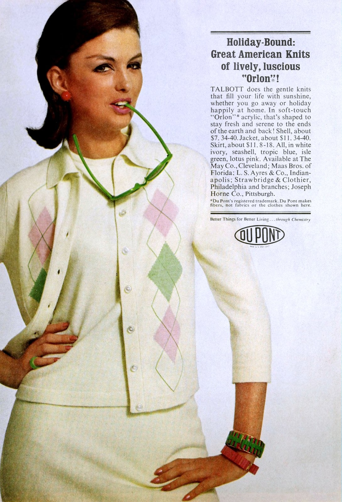 Pink and green argyle pattern vintage knit sweater on white (1964)
