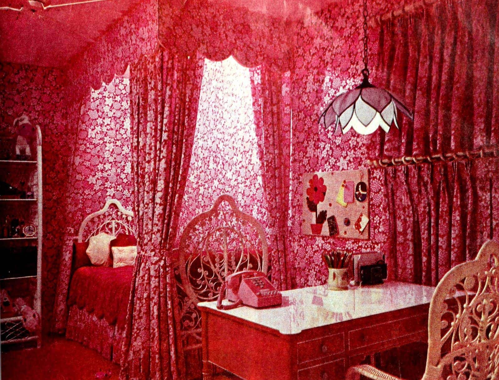 Pink retro bedroom with floral canopy bed and curtains (1971)