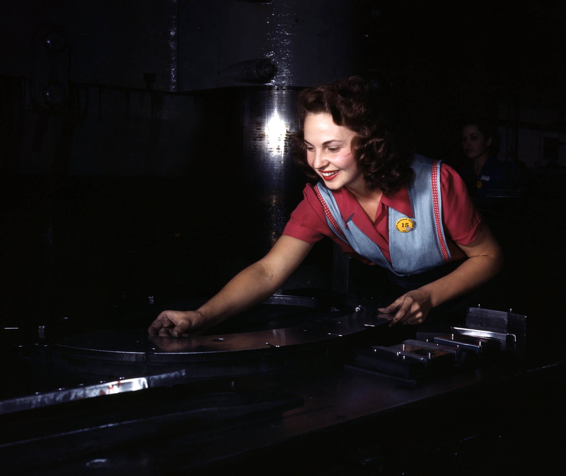 Placing metal parts on masonite at an aviation company during WWII