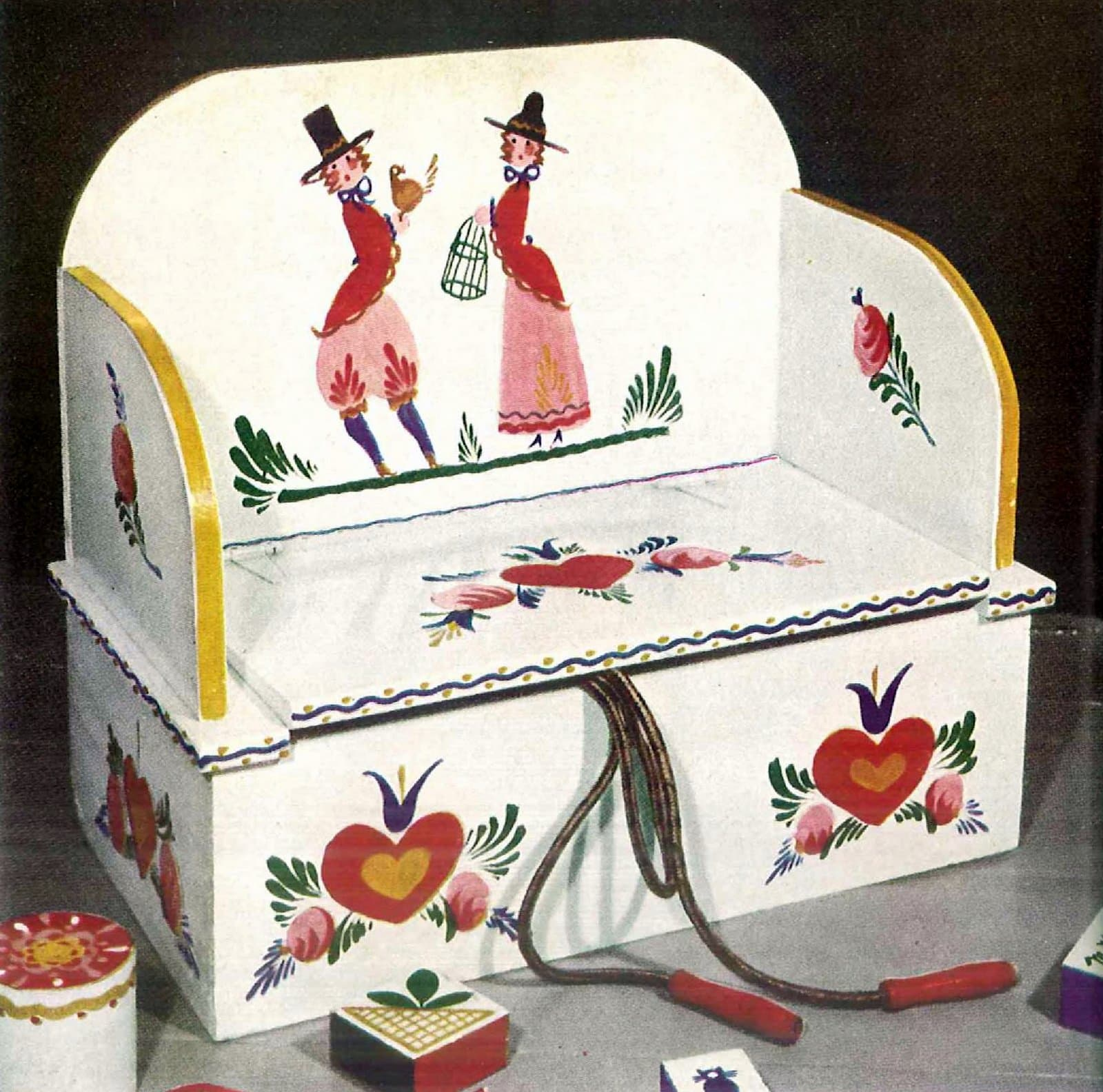 Play bench with a hinged cover made from an old dresser drawer