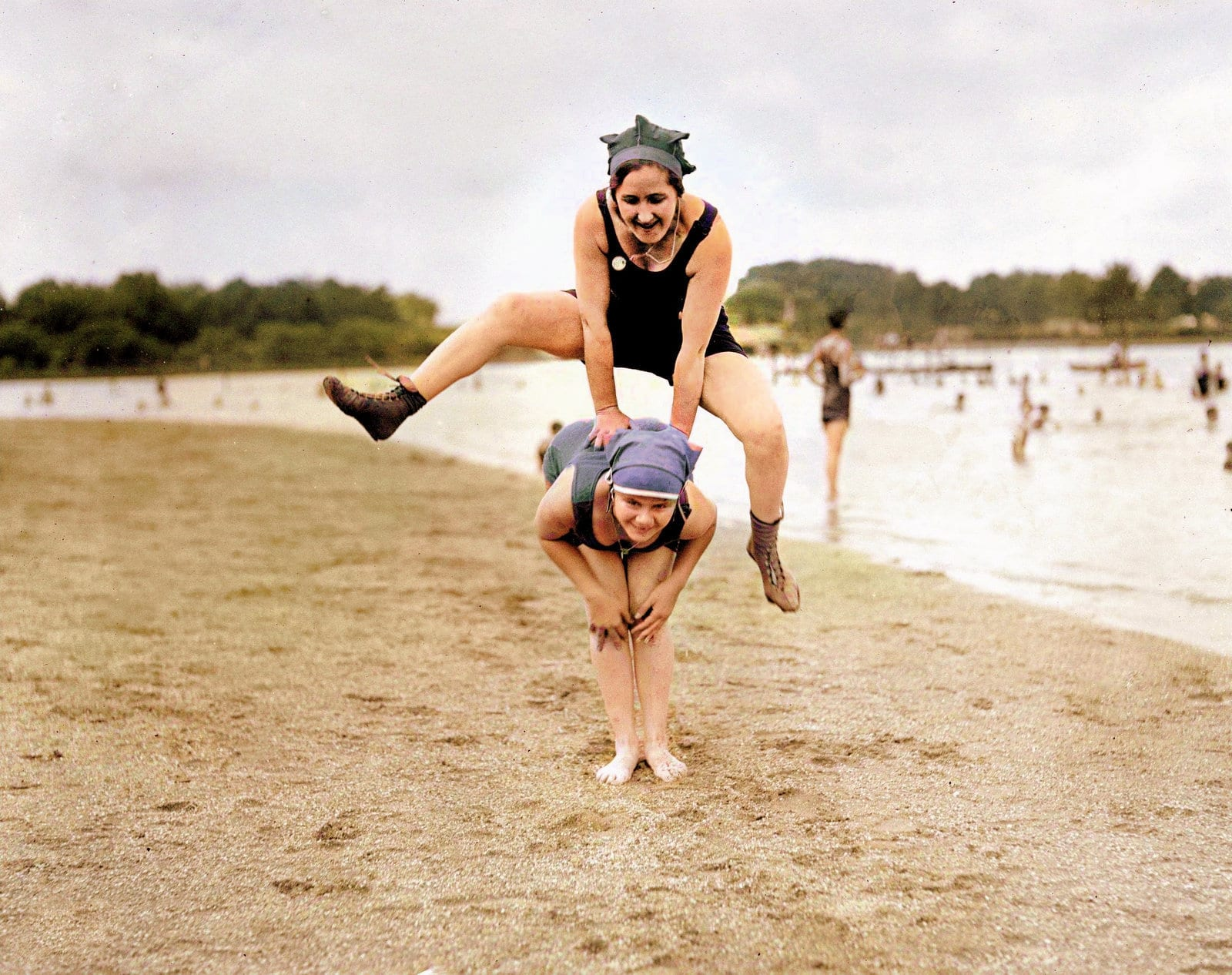 Playing leapfrog at the beach (1921)